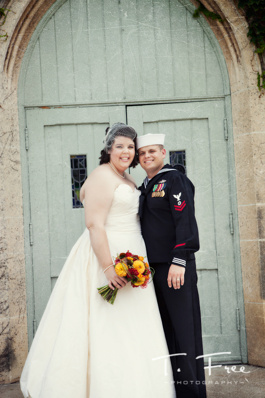 Bride and groom photo in front of church.
