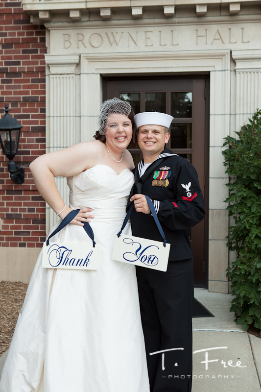 Bride and groom with diy thank you signs at Brownell-Talbot chapel.