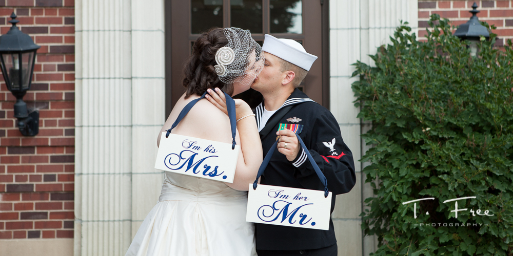 Cool DIY signs with bride and groom at Brownell-Talbot campus in Omaha.
