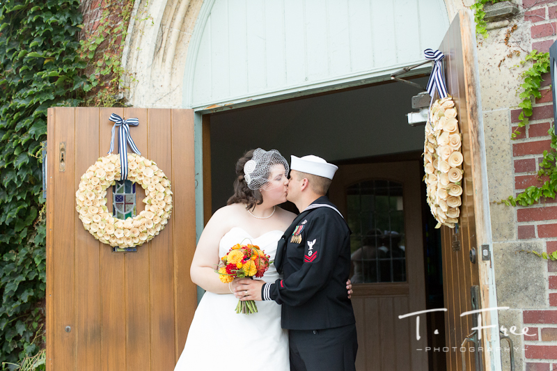 Beautiful picture of bride and groom kissing at Brownell-Talbot chapel in Omaha.
