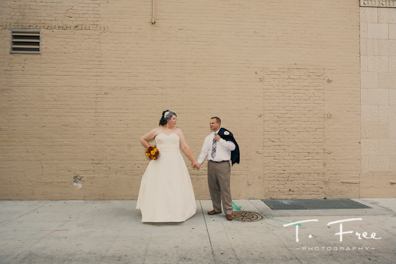 Outdoor wedding photo between the ceremony and reception in downtown Omaha.