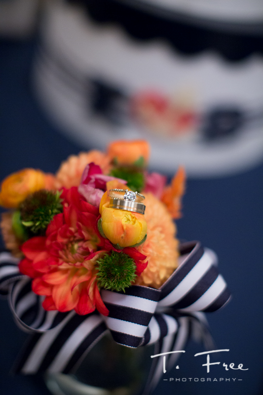 Flower and ring photo at wedding reception in downtown Omaha at The Paxton.