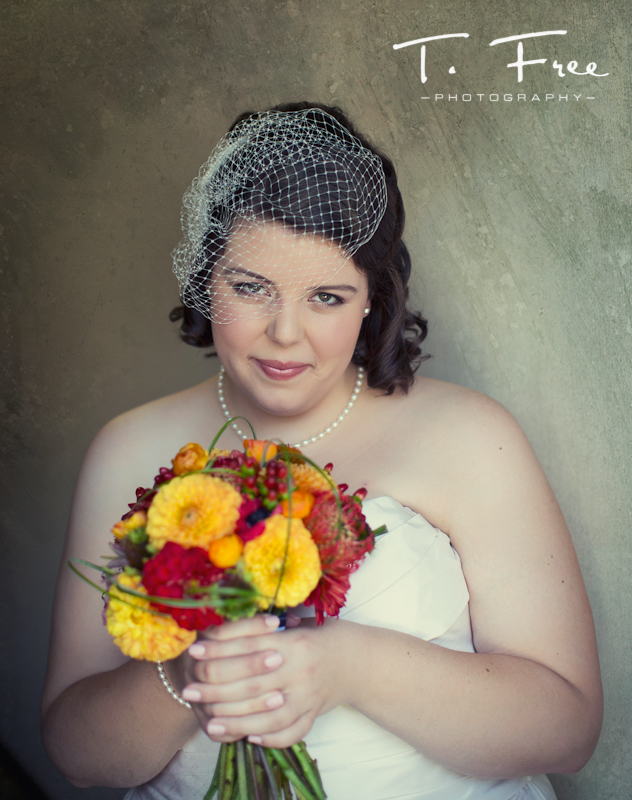 Gorgeous natural light bride with flowers at Brownell-Talbot wedding in Omaha.