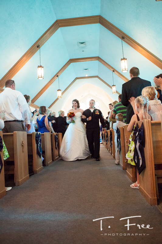 Bride and groom walking down the aisle at Brownell-Talbot chapel.