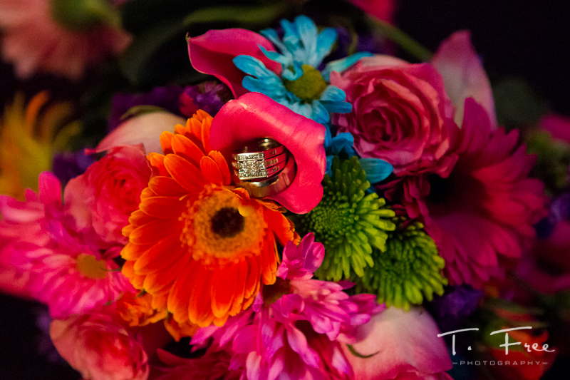 Bride and groom rings with flowers.