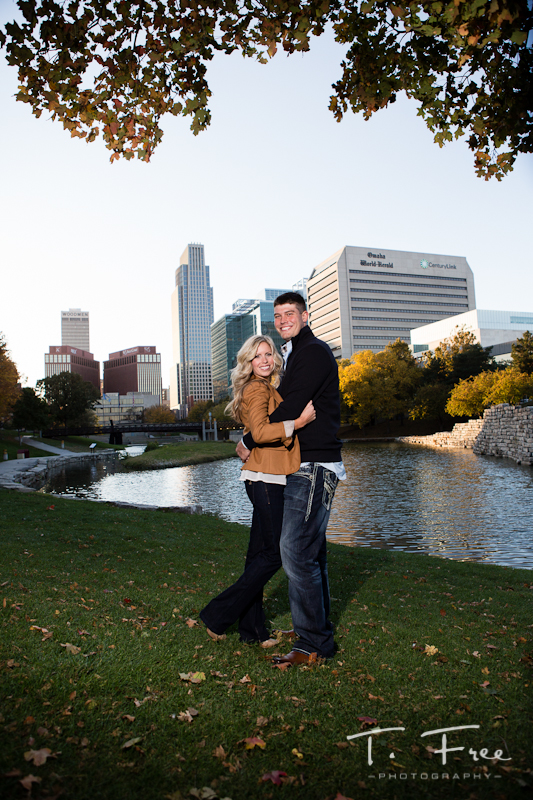 Downtown Omaha skyline engagement session.