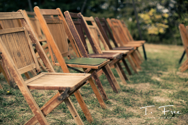 Classic wooden folding chairs at outdoor lincoln nebraska wedding.