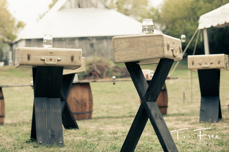 Custom made reclaimed suitcase tables at outdoor nebraska wedding.