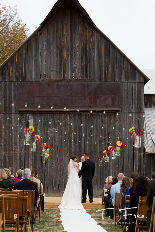 Outdoor nebraska barn wedding ceremony.