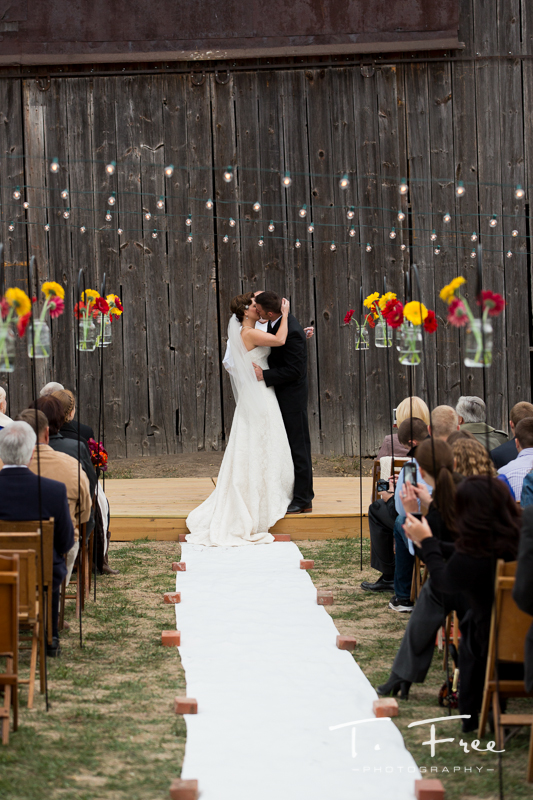 Bride and groom kissing at the nebraska vineyard ceremony.
