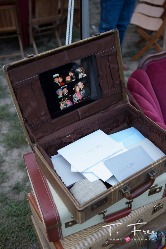 Custom made iPad vintage suitcase slideshow outdoor nebraska wedding.