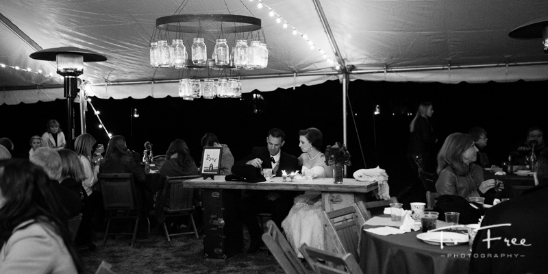Black and white of bride and groom at outdoor nebraska wedding reception.