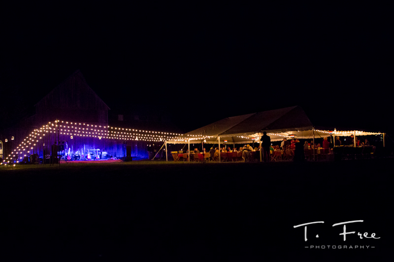 Outdoor nebraska wedding with live band and wedding reception.