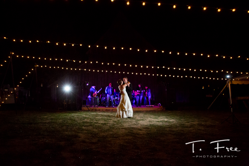 Bride and groom first dance to outdoor nebraska wedding live band.