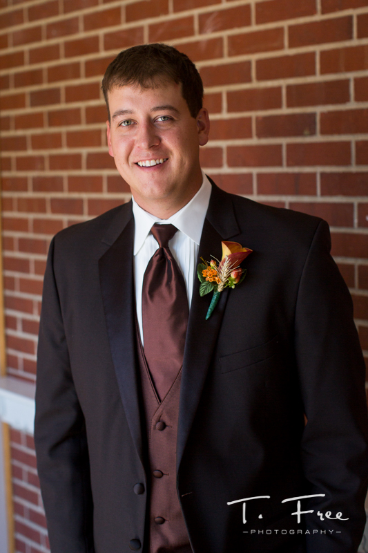 Natural light smiling Nebraska groom wedding image.