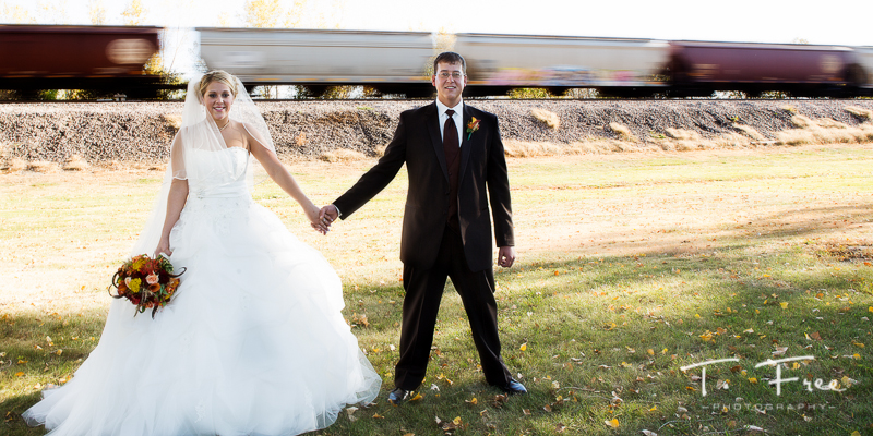 Nebraska wedding bride and groom moving train.