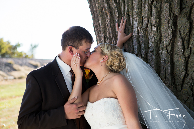 Creative Nebraska wedding image bride and groom kissing.
