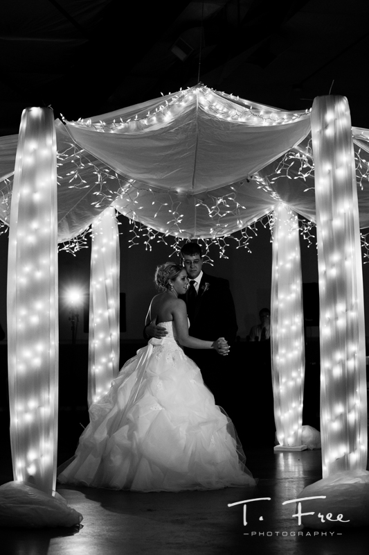 Bride and groom enjoying their first dance together.