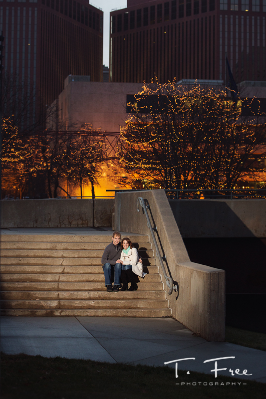 Downtown Omaha Christmas light engagement image.