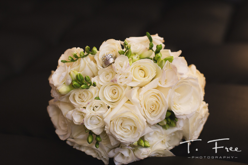 Flowers with wedding rings.