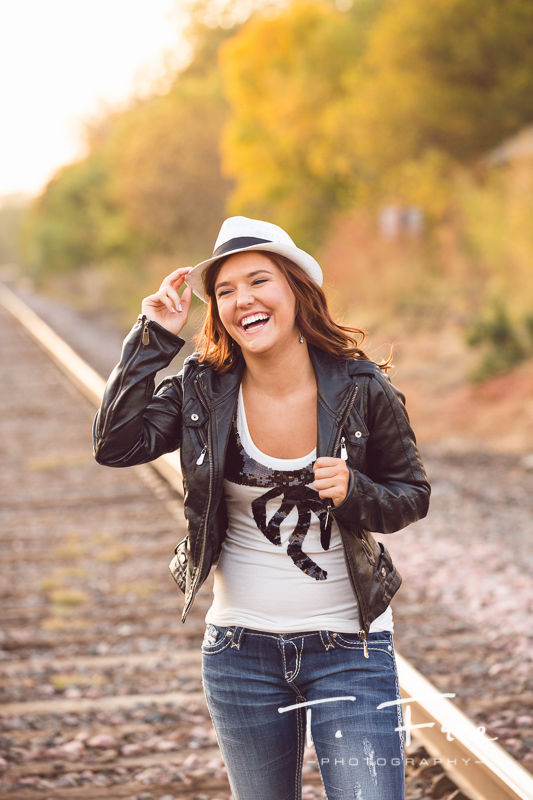 Fun laughing senior girl photo in Elkhorn Nebraska.