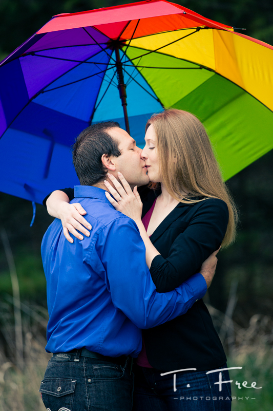 Colorful umbrella prop for engagement session.