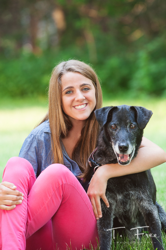 High school senior girl with her dog.