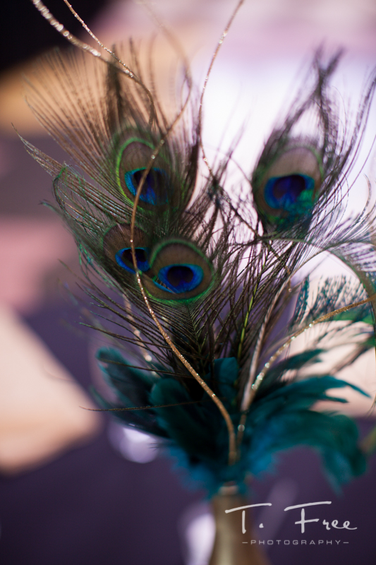 Peacock feather wedding details.