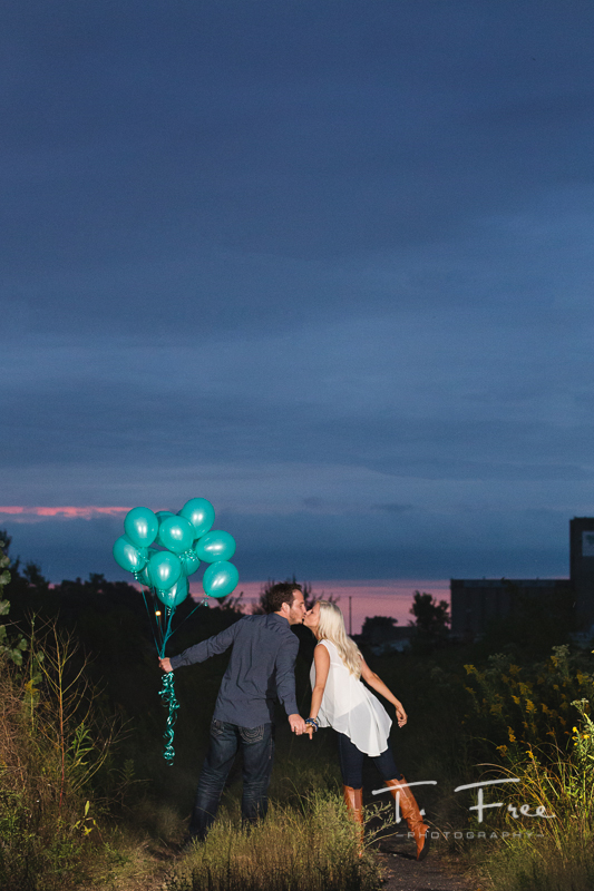 Downtown Omaha engagement session with balloons.