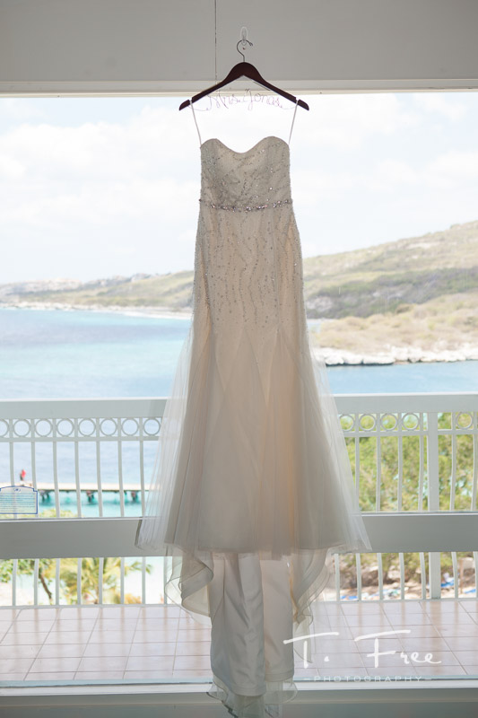 Wedding dress hanging overlooking Curaçao Hilton beach.